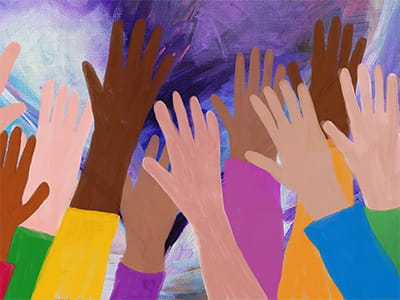 Movement Toward a Just Future - Hands raised by a diverse set of people