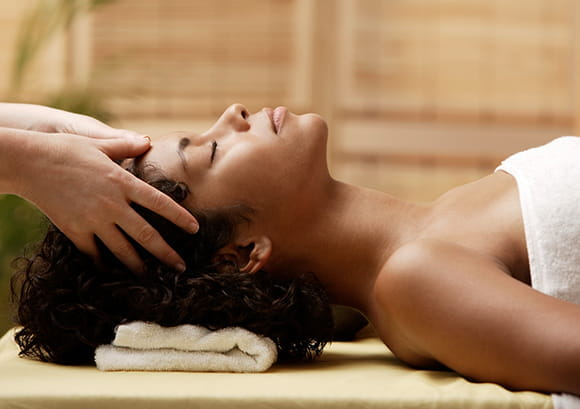Woman enjoying a scalp massage