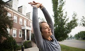 Woman stretching her arms over her head