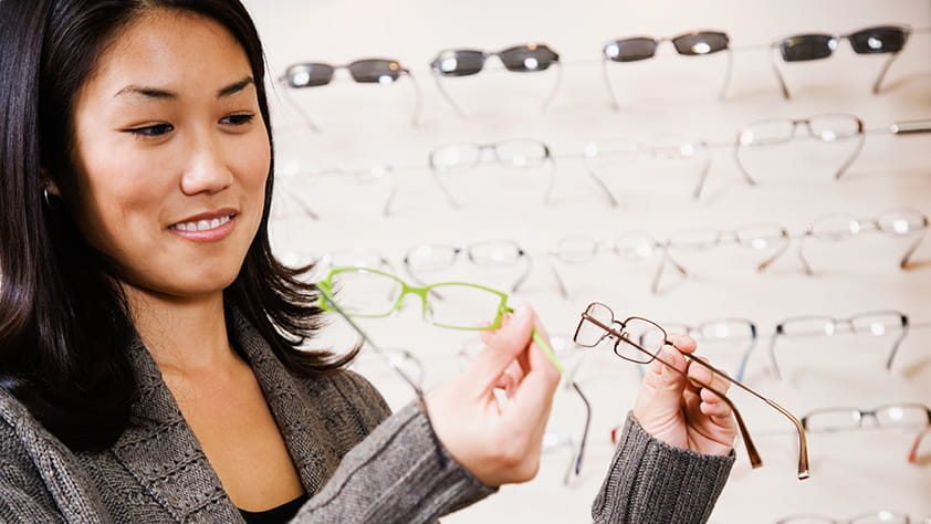 Woman comparing different styles of eyeglasses