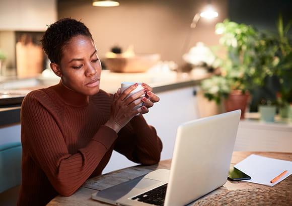 Concerned Woman Glaring at Computer Screen