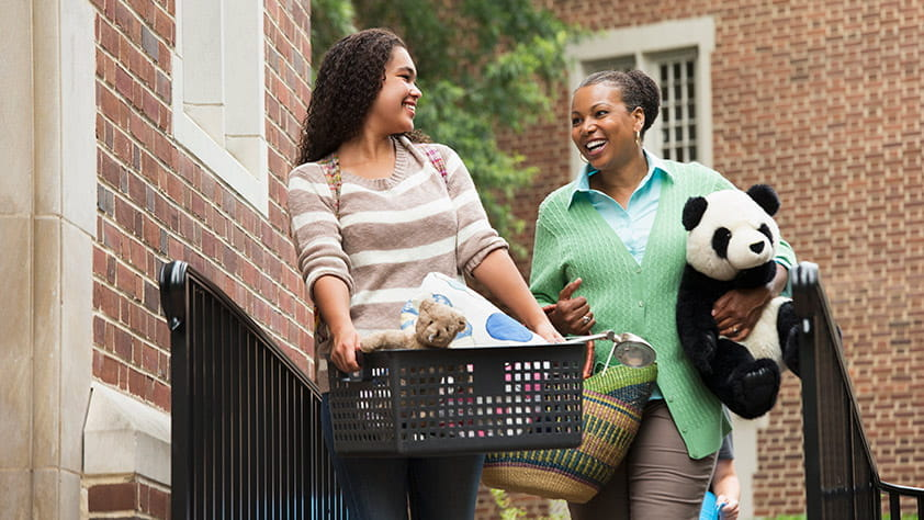 Mother and Daughter Happily Approaching College Dorm