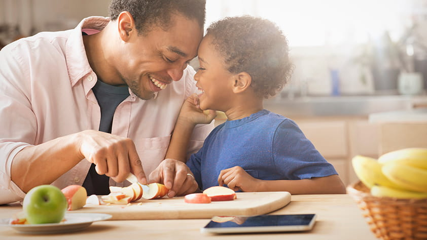 How to Kick Your Stress-Eating Habit - Father Teaching Son How to Eat Healthy