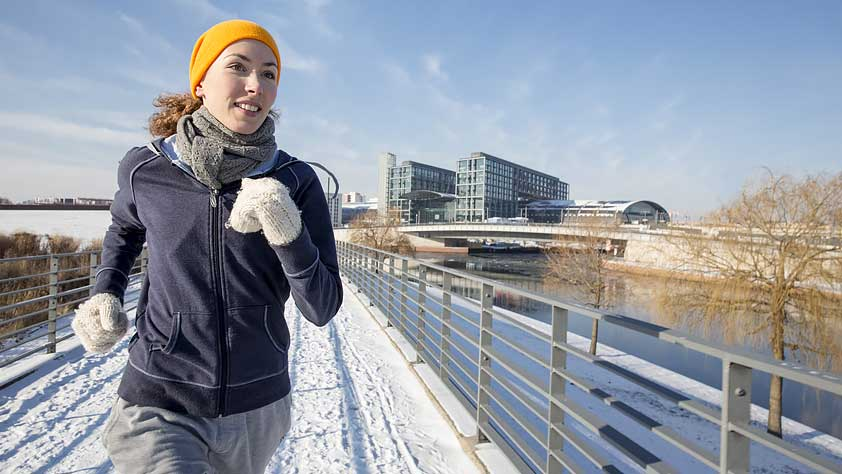 How to Stick With Your Fitness Routine - Woman Jogging in Winter