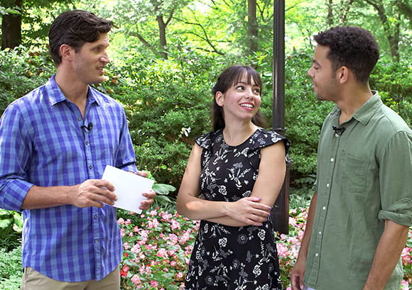 Young couple in a park being interviewed and asked questions about life insurance