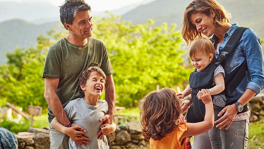 Family of Five Smiling and Laughing