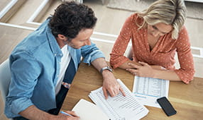 Man and Women Reviewing Paperwork