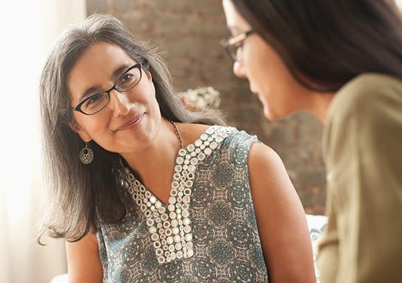 Women Listening Intently to Female Speaker