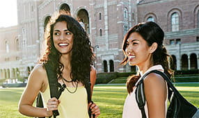 Female students talking on college campus