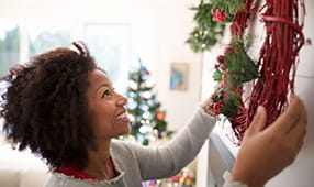 Woman Hanging Christmas Wreath