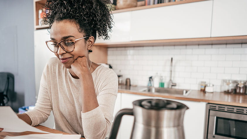 6 Smart Moves to Make Before December 31 - African-American Woman Reading Paperwork