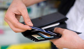 Male Hands Close Up of Credit Card Being Placed into Wallet