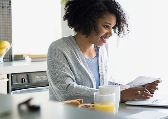 Female Happily Paying Bills Online