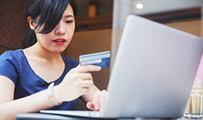 Female Adding Credit Card Number to Online Payment