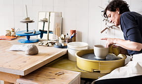 Woman in Her Pottery Studio Making a Bowl