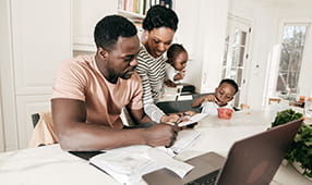 African American Family Enjoying Going Over Bills