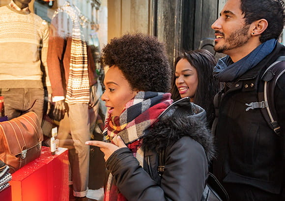 Friends in City Window Shopping During the Holidays