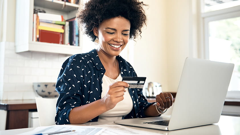 Woman Adding Credit Card to Online Payment