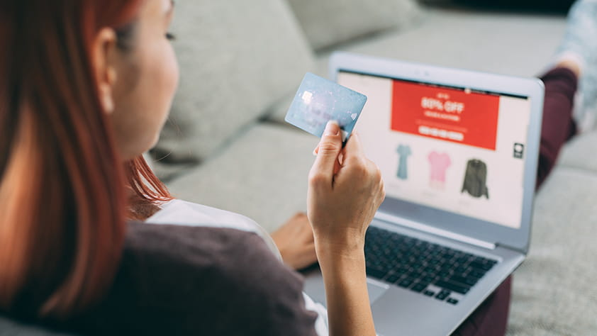 Woman Using a Credit Card to Shop Online