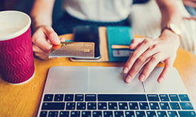 Close Up of Woman's Hands Adding Credit Card to Online Payment