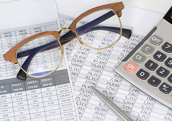 Eye Glasses on Top of Financial Statements