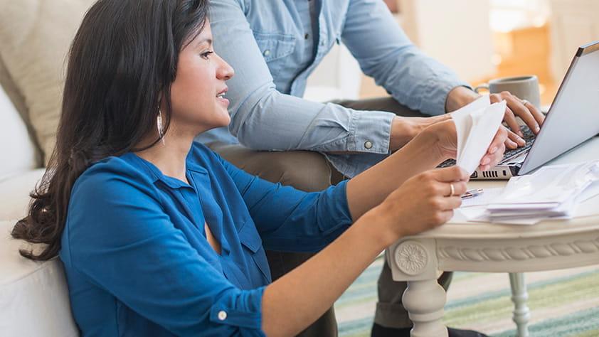 Couple Reviewing Finances Online