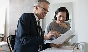 Male Financial Planner Assisting Woman with Finances