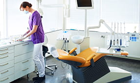 Dental Hygienist Prepping Dental Office Chair