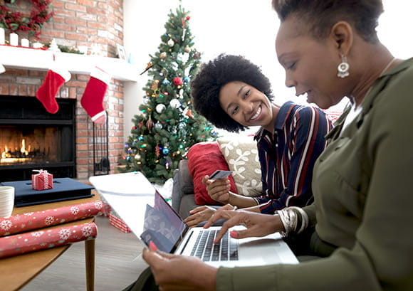 Daughter Teaching Mother Laptop on Christmas Day