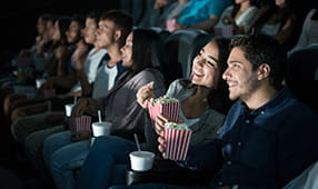 Close Couple Enjoying Movie at Theater