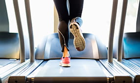 Close Up of Female Legs on Treadmill