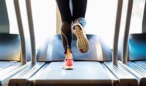 Close Up of Female Legs on Treadmill