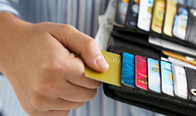 Hand Pulling Out Credit Card