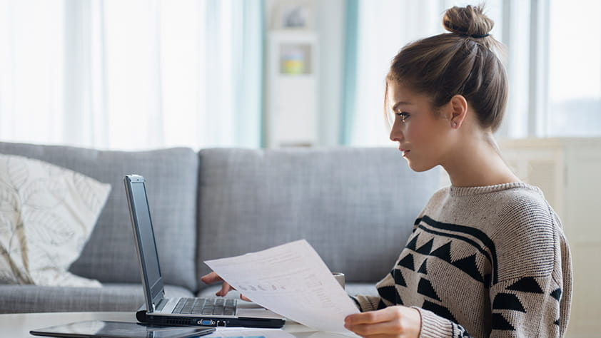 Female in Twenties Reviewing Finances Online