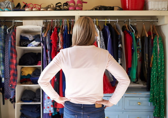 Woman Looking Over Closet