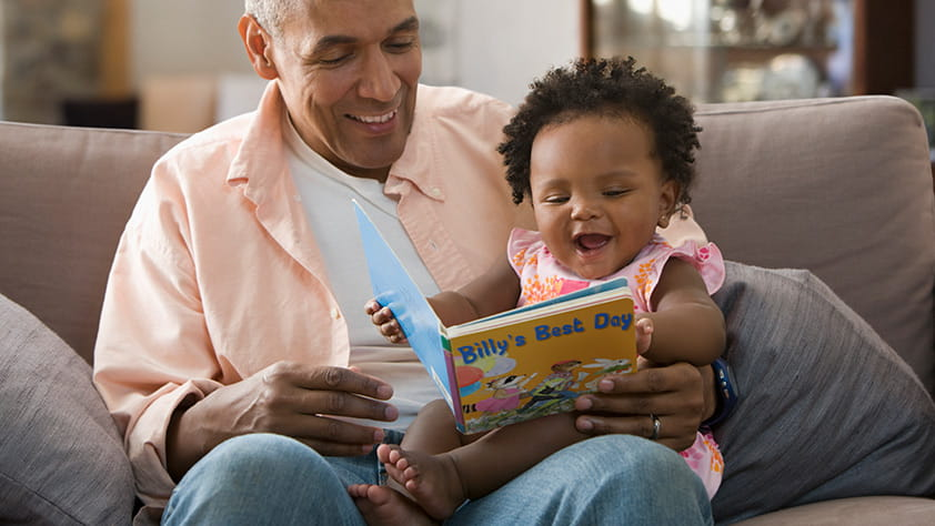 Grandparent Reading Book to Child