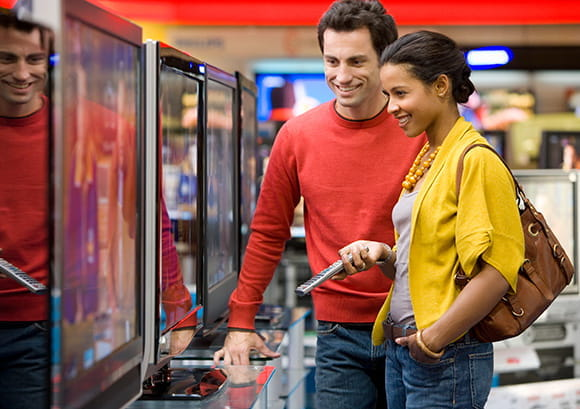 Couple Looking at TVs to Purchase