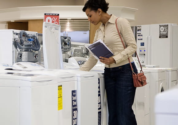 Woman Looking at a Washing Machine