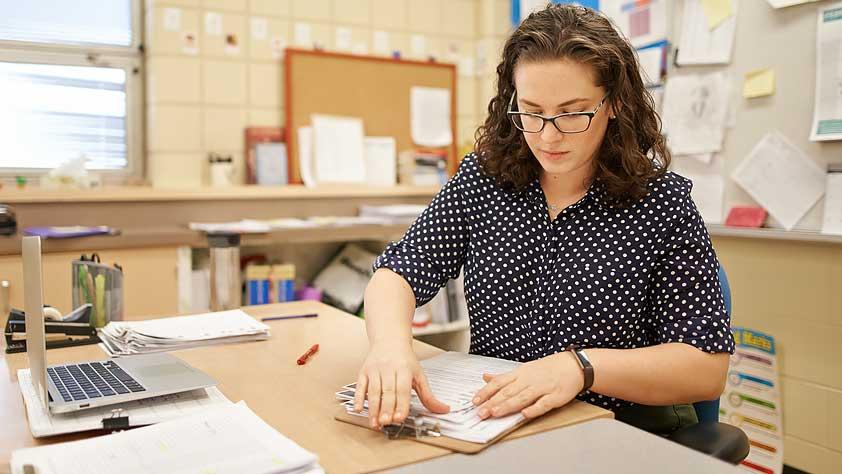 Female Teacher Preparing Notes