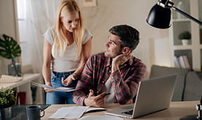 Worried Young Couple Paying Bills Online