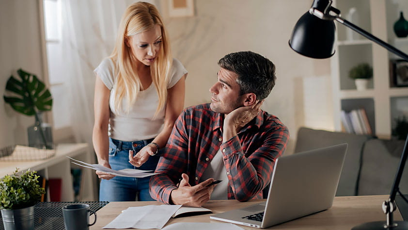 Worried Young Couple Paying Bills Online - What to Do if Your Credit Card Application is Denied