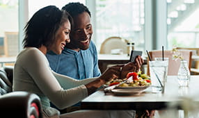 African American Couple Enjoying Meal