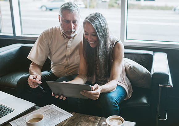 Father and Daughter Reviewing Tablet