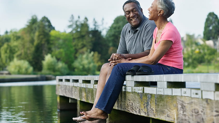 Retired African American Couple Enjoying Time Relaxing on Dock