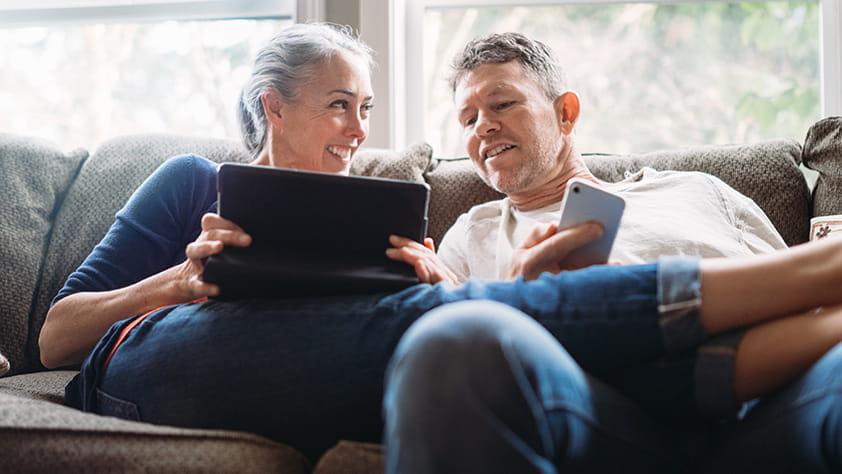 Couple checking their retirement savings