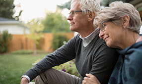 Senior Couple Reflecting on Their Life in Backyard