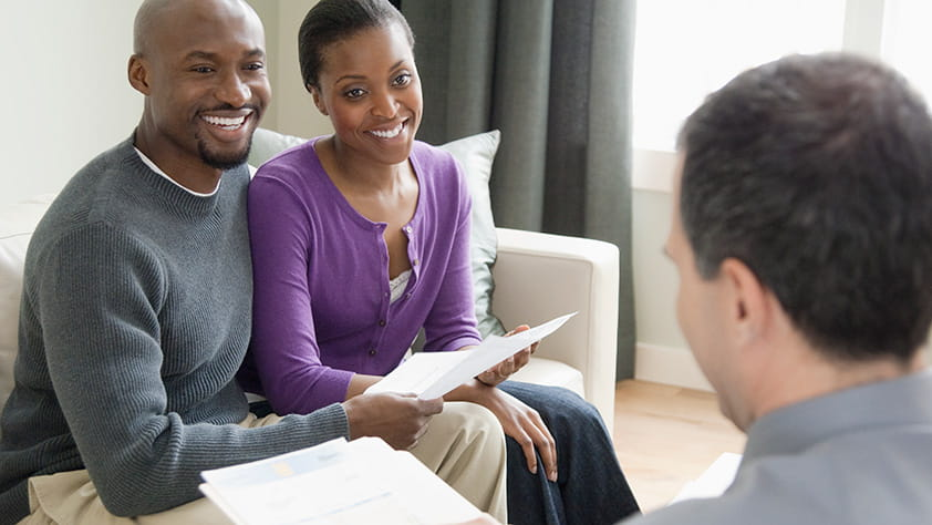 Professional Couple Listening to Financial Overview