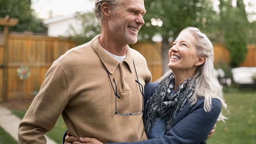 How Much Do You Really Need to Retire - Old couple smiling at each other