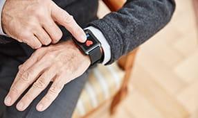 Male Hand Touching Smartwatch