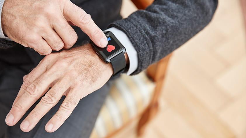 Senior man wearing a smart watch